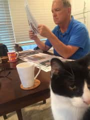 Larry and Boo enjoying morning coffee and reading the newspaper while Boo's family vacations in France