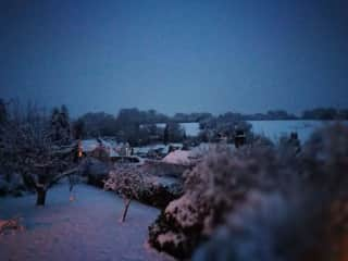 Scene across the village in the snow from front window!