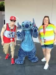 Travis and Desiree with Stitch at Disneyworld.