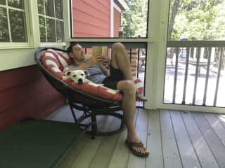 My husband Clinton on the back porch with Lucy