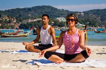 Me doing yoga on Kata Beach in Phuket, Thailand