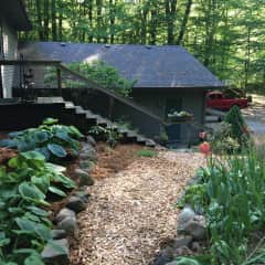 Looking at the garage and steps up to the upper level.