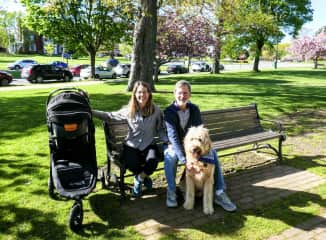 Mary and Rick on a walk in the park with grandaughter Maggie and grandog Barney.