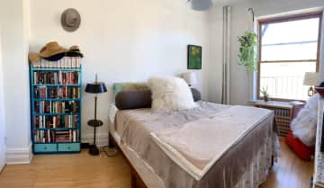 Our bedroom, with queen-sized memory foam bed (and fluffy pillows)