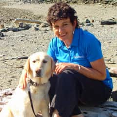 Terri at the beach with her yellow lab, Belle (2014)