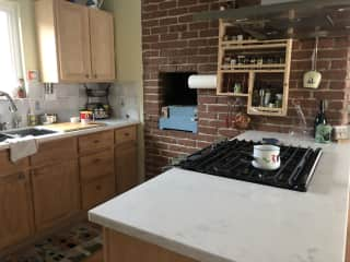 Kitchen with gas stove and indoor grill