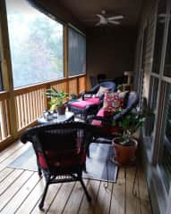 Porch off master BR & LR / Small dining table at end of porch/great place to relax and watch the birds.