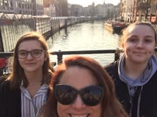 My travel buds. My daughters. Lily(on the left) Mary (on the right). Me in the middle. We took this picture the spring of '18  in Amsterdam.