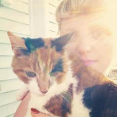 This is me with my family cat Cupid, she lived to be 19