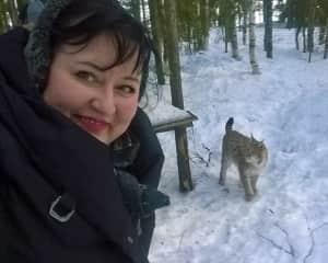 Päivi inside Eurasian Lynx fence at Kuusamo Predator Center, Finland