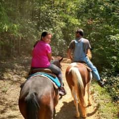 Me and my daughter horseback-riding (I am taking the photo)