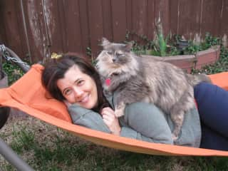 My cat Puffy and I in my yard. I rescued her 2006 when she was only 5 weeks old.