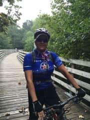 Linn bicycling the Creeper Trail in Virginia