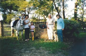 Circa 2000, family group by the gate of our property