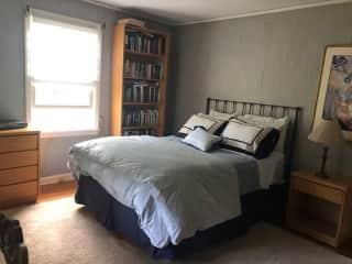 Bedroom has TV.