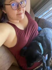 Me snuggling with my sister's cocker spaniel