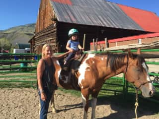 Lucy, my most recent horse with my 3 year old niece in the saddle