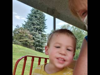 Enjoying  the park with my grandson.