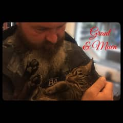 Grant giving Muen (dive shop cat) her morning cuddles. (until she grew tired of it and jumped out of his arms)