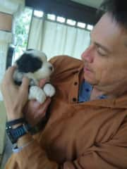 My husband with one of the 6 puppies