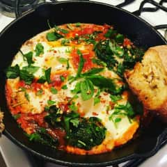 I love cooking. Here's some baked eggs in red sauce I made.