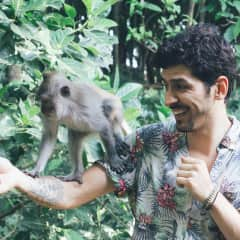 Tury with a new friend in a monkey sanctuary in Bali