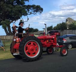 Family fun in the annual tractor parade at the bach.