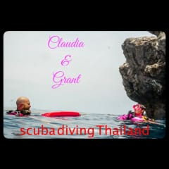Grant and Claudia surfacing after diving Sail Rock, Thailand.