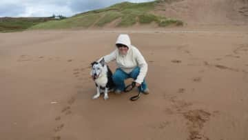Me with the wonderful dog in my care from my Trustedhousesitters pet sit in Scotland!