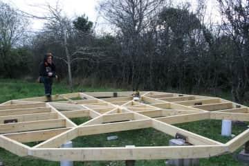Paul building a deck for a yurt