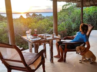 Shawn and mr Digglesby watching sunset at our Island Resort in Lamu, Kenya