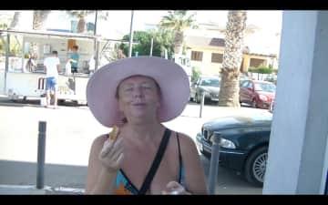 Vicky enjoying churros at Vera Playa, Spain.