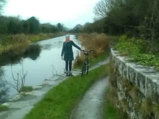Bridie cycling the local canal path