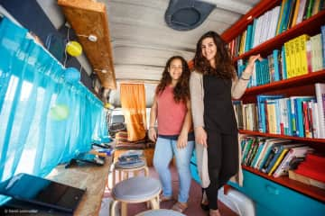 My colleague Laura and I, co-founders of a mobile library for refugees in Greece
