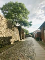 City center. The old wall used to prevent invasions in medieval times still stands.