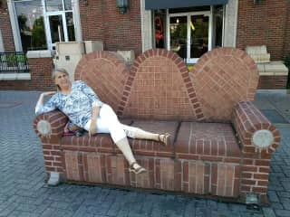 Traveling in Alabama, cool brick couch on sidewalk 2019