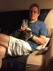 Phil with a cat we cared for, Daisy. She loved hanging out with us!