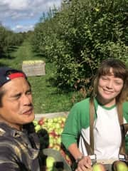 Rand and Dayl pick apples in Vermont.