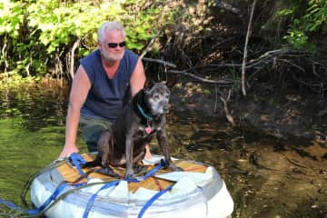 Hal and Phlox on a wilderness camping adventure; she was floated in and out on the creek as the rocks were too hard for her to negotiate after awhile