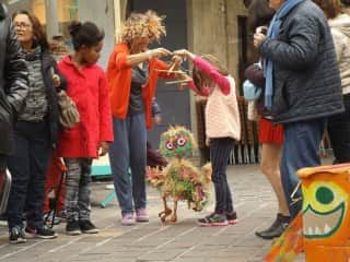 Showing children how to animate puppets at the Charleville Puppet Festival (2017)