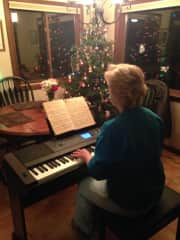 Ann playing the keyboard at Christmas