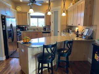 The kitchen has alderwood cabinets, hickory floors, a gas stove, stainless appliances and a large corner pantry.  The view from the kitchen sink is lovely in all seasons.