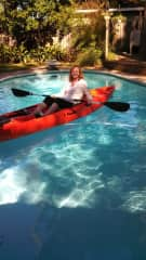 Testing out the kayak in the backyard pool.