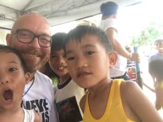 I helped build houses in a slum in Manila and payed with the kinds.