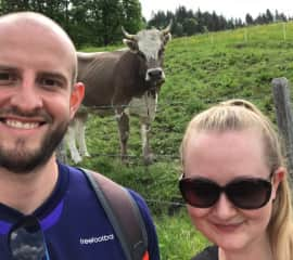 Paddy and Rebecca on a hike in the Swiss countryside