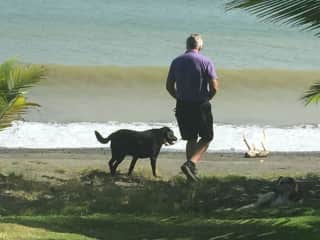 Carl and Zoey, one of our pet sits, walking on the beach