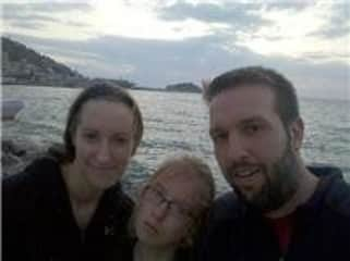 Jennifer, Lydian, and John in front of the Aegean Sea