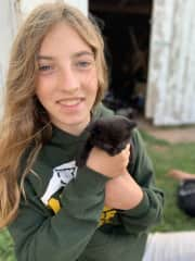 This is our 13 years old with one of the kittens.