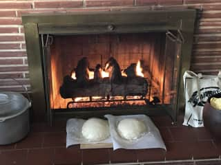 Sourdough proofing by the fireplace.