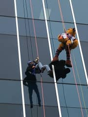 Me and the local mascot rappelling down the side of a building to benefit a local charity.